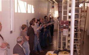 Photo:Many hands make light work. Engineering managers watch anxiously over the operation with crossed fingers!