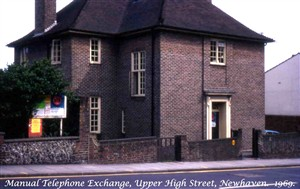 Photo:The new purpose-built manual telephone exchange was erected in the Upper High Street in 1930. It was opened in 1931 with a CBS2 manual exchange on the ground floor. This was superseded after the war by a CB10 manual switchboard on the first floor that eventually grew to 15 positions before it closed in 1969. The building was demolished in 1969 to make way for the new Post Office on the same site.