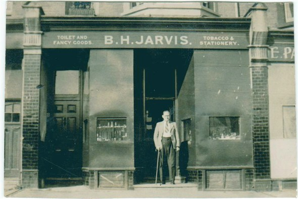 Photo:B. Jarvis outside his shop in Meeching Avenue