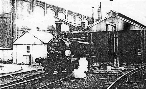 Photo:Amid the smoke of exploding detonators, and suitably decorated with a wreath, after 65 years of service the last Terrier leaves the shed on 18th August 1963.  The shed closed completely on 9th September 1963.