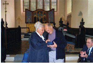 Photo:Jacques returning to Great Massingham in 2005, for the first time since 1943, to receive an engraved lead crystal plaque from the villagers of Great Massingham on behalf of all the Free French airman who flew from the village, as a token of gratitude for the efforts and sacrifice made by them towards winning the war in Europe.