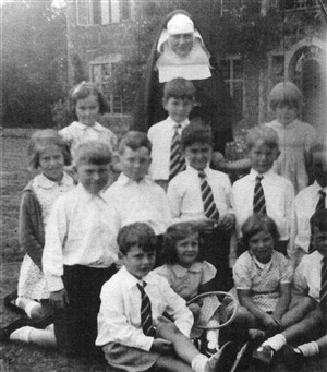 Photo:Newhaven Convent Children at Highfure House. Josie with the tennis racquet, Dick behind her to the left.