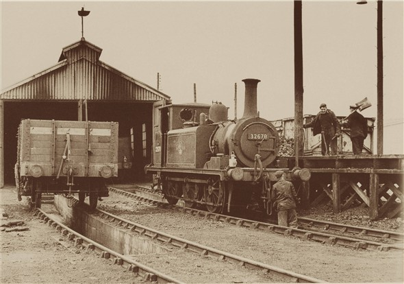 Photo:Terrier 32670 being coaled outside the Newhaven shed - C1960