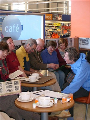 Photo:L-R: Mrs Balcombe, Joanna, Colin Holden, Peter Bailey, Sylvia, Jackie & Heather Holden share photos, memories and a coffee