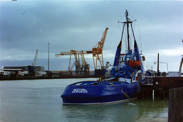 Photo:At her home berth. Note the redundant cranes on the East Quay and the stern of the Exxtor 1 a freight ro-ro ferry that served the route for a few years.