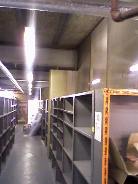 Photo:The empty stock room upstairs