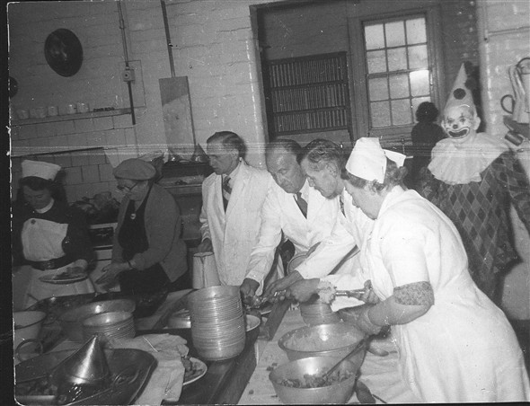 Photo:Serving Christmas dinner, c. 1952