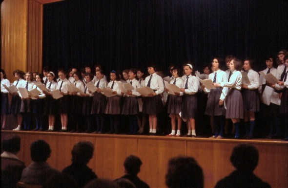 Photo:The choir on stage in the main hall.