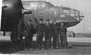 Photo:Jacques far right with his crew in front of their plane