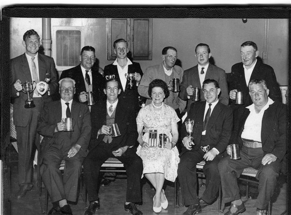 Photo:Darts trophy presentation at The Crown, Newhaven.  Cyril Walton (my father-in-law) is in the front, second from right. Who are the others?