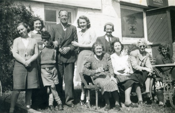 Photo:L-R: unknown, Marcia Stapley, Edwin Warnes, Bert Lillywhite, others unknown. Taken at the Rose Cottage Inn, Alciston, late 1940s