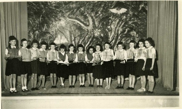 Photo:School Pantomime 1955 - Little Red Riding Hood (I think!).  Left to right - Vera Jeffrey, Sylvia Jeffrey, Pal Clear, Doreen Ball, Rosemary Mullett, Jean Kingshot, Geraldine Greenslade, Carol Eager, Angela Groves, Barbara Sturmey, Irene Bulman, Margaret Willy, Susan Rayner, Doreen Molyneux, Carol Page