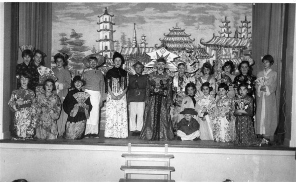 Photo:Aladdin - 1956.  Back row left to right - Doreen Molyneux, Vera Jeffrey, Yvonne Hadley, Richard Halpin, Susan Rayner, Christopher Coleman, Graham Amy, John Poulter?, Melody Rhona?, ?, Susan Farrow, Carol Page.  Front row left to right - Suzanne Black, Barbara Sturmey?, Brenda Delacourt, Sheila Scarth, Carol Eager, Susan Ingram, Linda Everest.  The boy in the front could be either Jim or Colin Page.