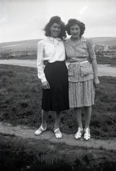 Photo:Peggy Vinall (then Saunders) & Marcia Stapley (daughter of Mrs Warnes) probably late 1940s [Denton Island behind]