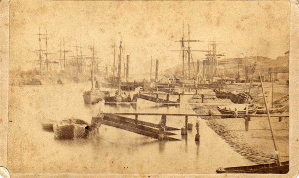 Photo:A very early photograph of then busy Harbour taken from the River Wall.