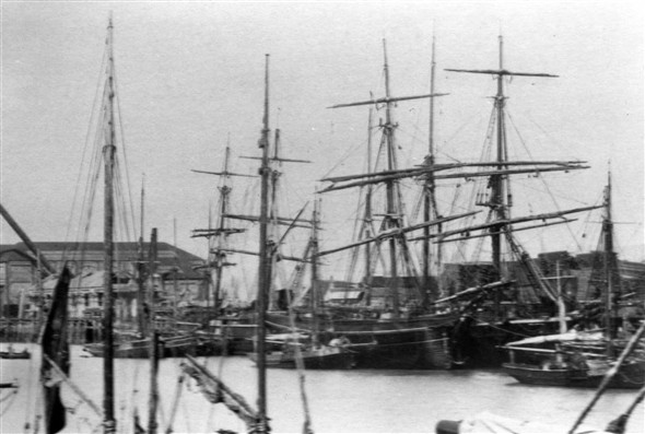 "Photo:Putting the roof on the carpenters/paint workshop. The square rigger shown front right is the ""Emily Smeed""owned by J Bull."
