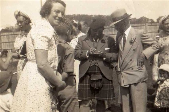 "Photo:The Scottish Music Hall Comedian and Singer, he was famous for the song ""I belong to Glasgow"",  seen here with Mrs Bowles the wife of farmer Bowles from Farm Road, now Court Farm Road. Their house is still standing."