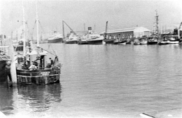 Photo:Looking up river from the Riverwall showing a ferry at the Marine workshops berth and two of the paddlers from the Portsmouth/Ryde crossing. Probably wintertime and laid up until the following summer season.