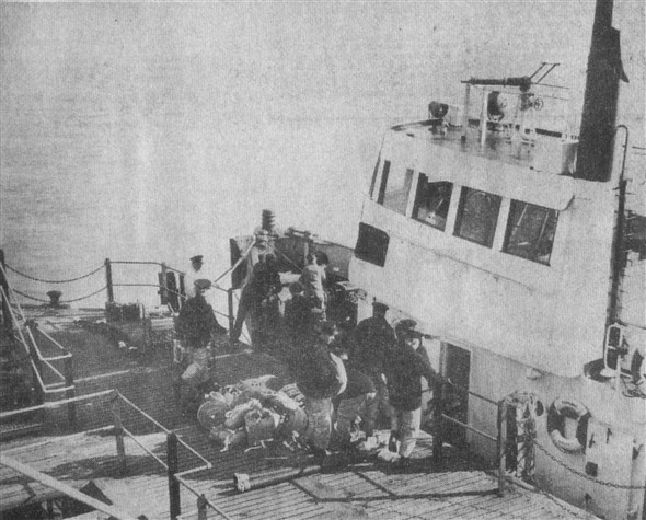 Photo:Firefighting equipment being loaded on board Dominant at Eastbourne Pier. You can see the high pressure water cannon on top of her wheelhouse. Meeching was similarly equipped.
