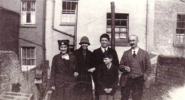 Photo:Photo taken at the rear of 39 Meeching Road c1927. L-R: Sister Myrtle (wearing her Convent Day School hat), Olive Archer (daughter of Freddy), brother Ray, me (Peter Bailey) and Dad. Note the meat safe on the left dividing wall and the glass top of the cold frame. This was carried by me (Peter) and neighbour Reg Hibling (who died recently in 2008) to 66 Hillcrest Road when we moved there. Reg's ball had come over wall earlier and broken a pane of glass hence him helping to carry it after repair!