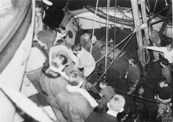 Photo:Some of Sitakund's crew being transferred from a French trawler to HMS Mohawk.